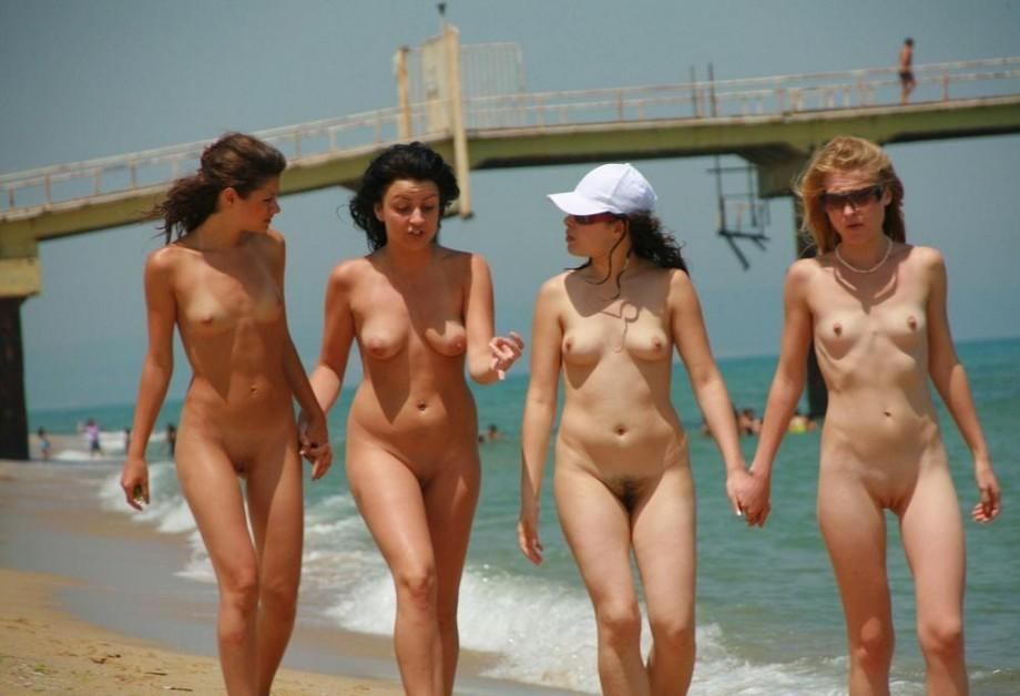 Four best friends walks naked on nude beach with wild talk