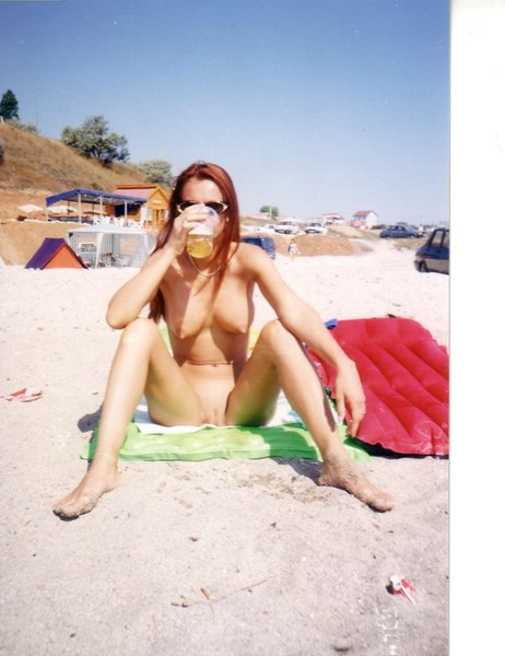 Nudist beach with horny young naked girls drinking a cold tasteful beer