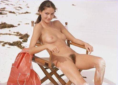 Smiling pretty chick sitting on chair with her furry twat in free nature