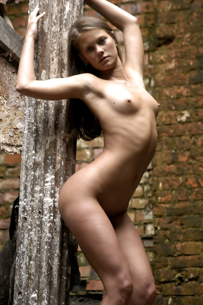 Amazing beauty naked with stunning curves and sitter hard firm nipples lost in the ruins