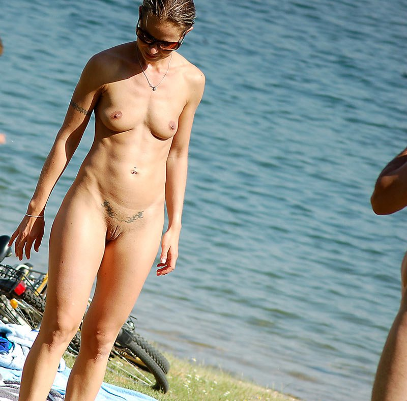 Naked skinny babe at nudist beach with shaved tattooed snatch and marvelous bumpers