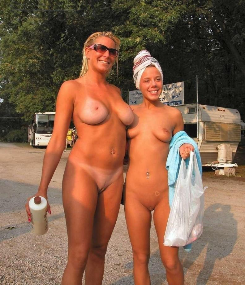 Chubby girlfriends with divine look pierced belly and firm globes naked preparing for the beach