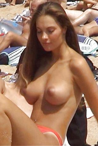 Topless lascivious lass with fantastic huge knockers and pierced belly