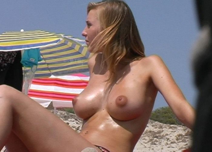 Big brown nipples hot babe caught topless exposing her huge breasts on a nudist beach