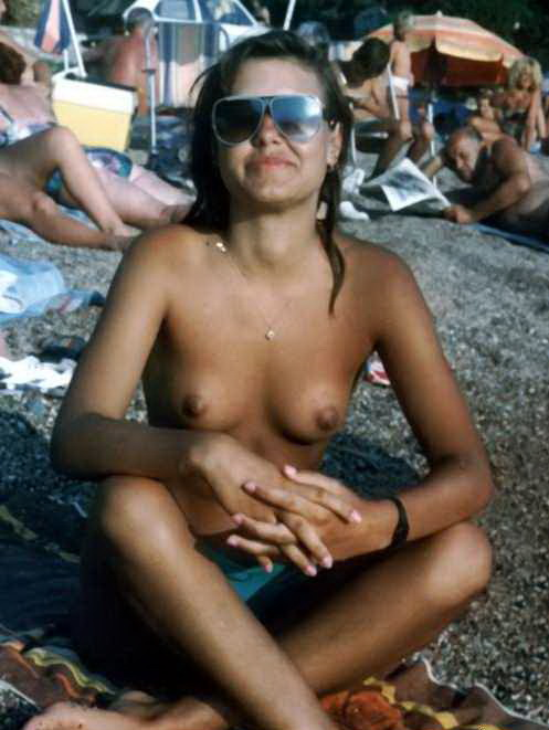 Brown sugar babe at the beach topless and enchanting wearing sunglasses posing sexy for boyfriend