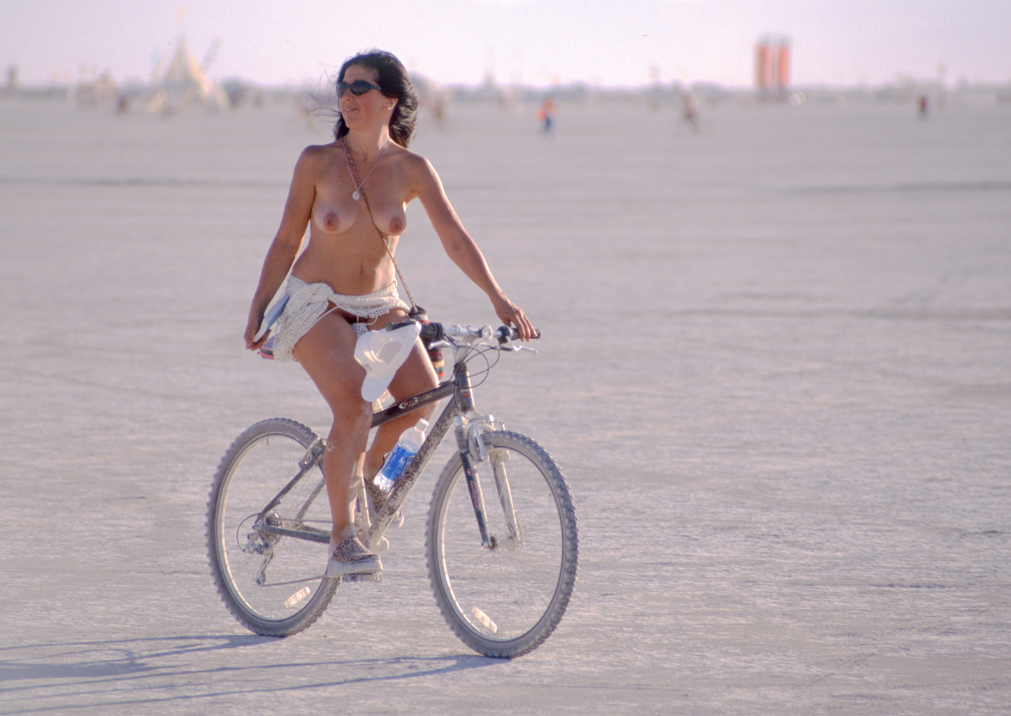 Naked bicycle girl on bike