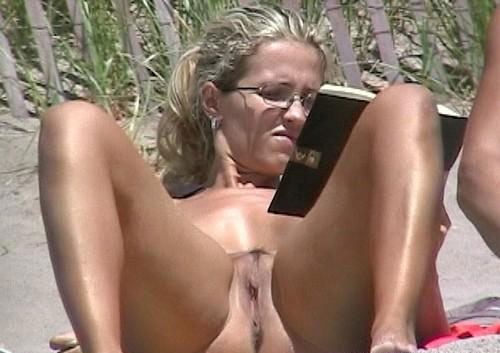 Delicious naked milf parades her muff in the open