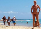 Naked milf poses like shes in a postcard