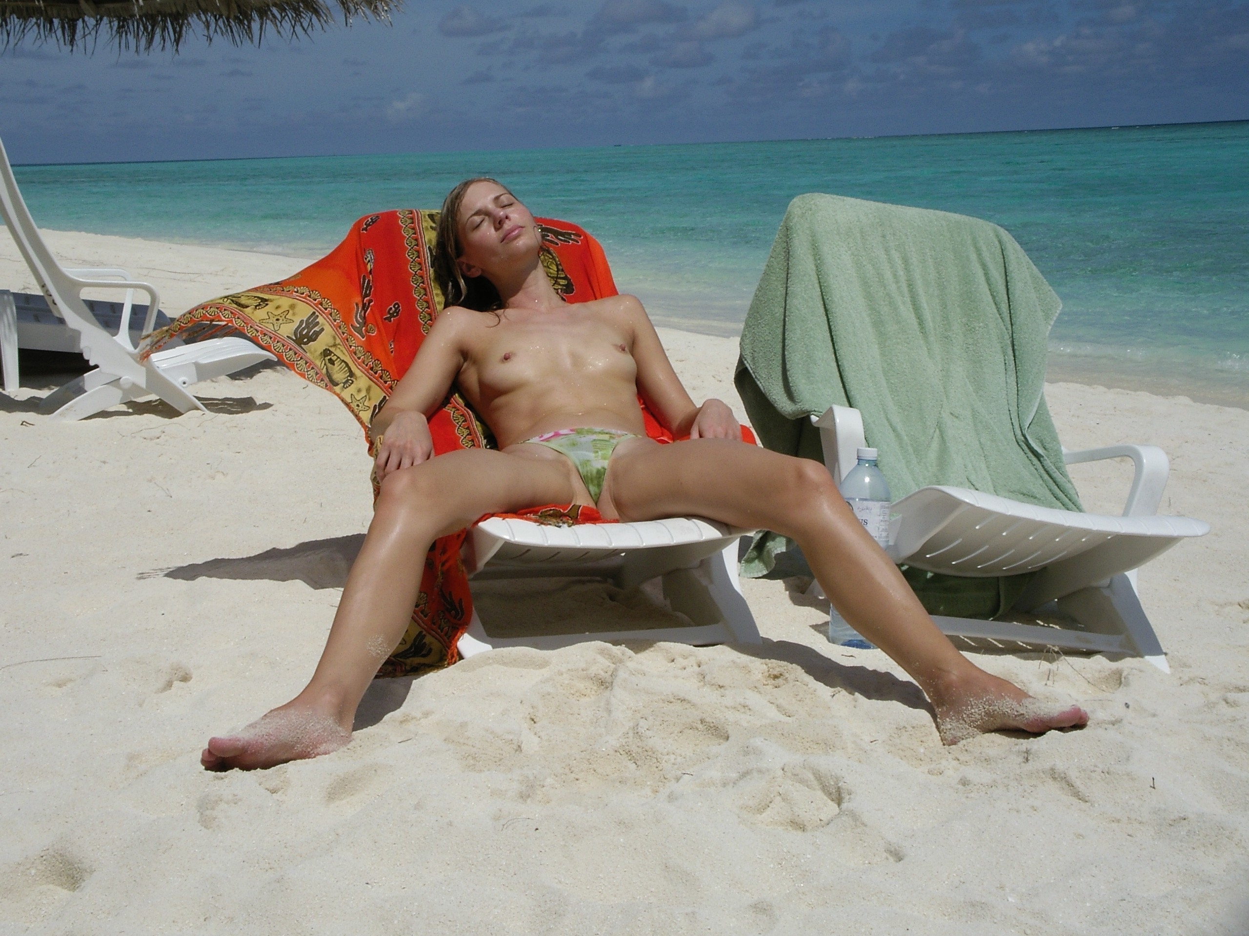 Nude beach girls sunbathing naked