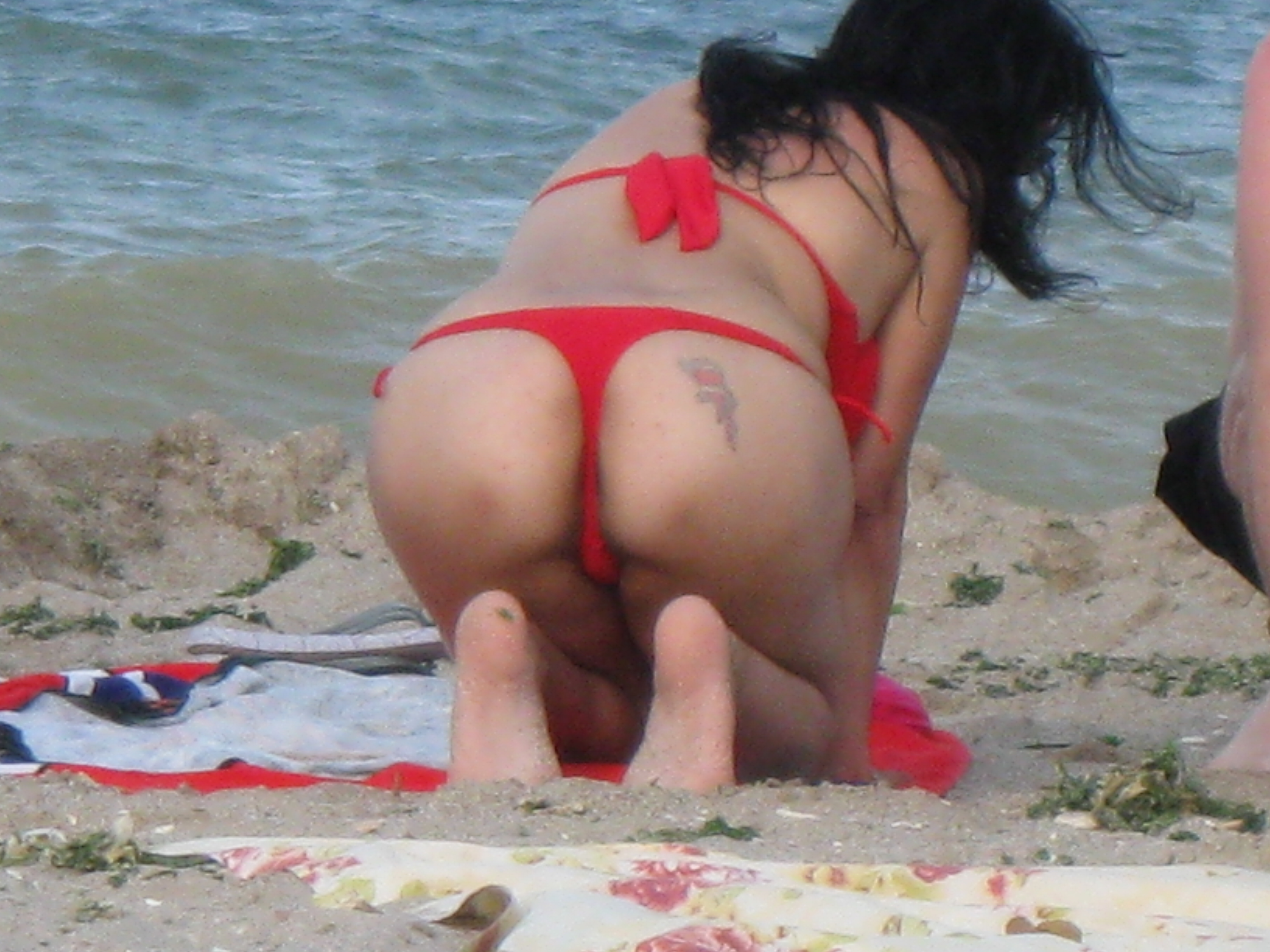 These bikini thongs draw attention to her nice tattooed ass