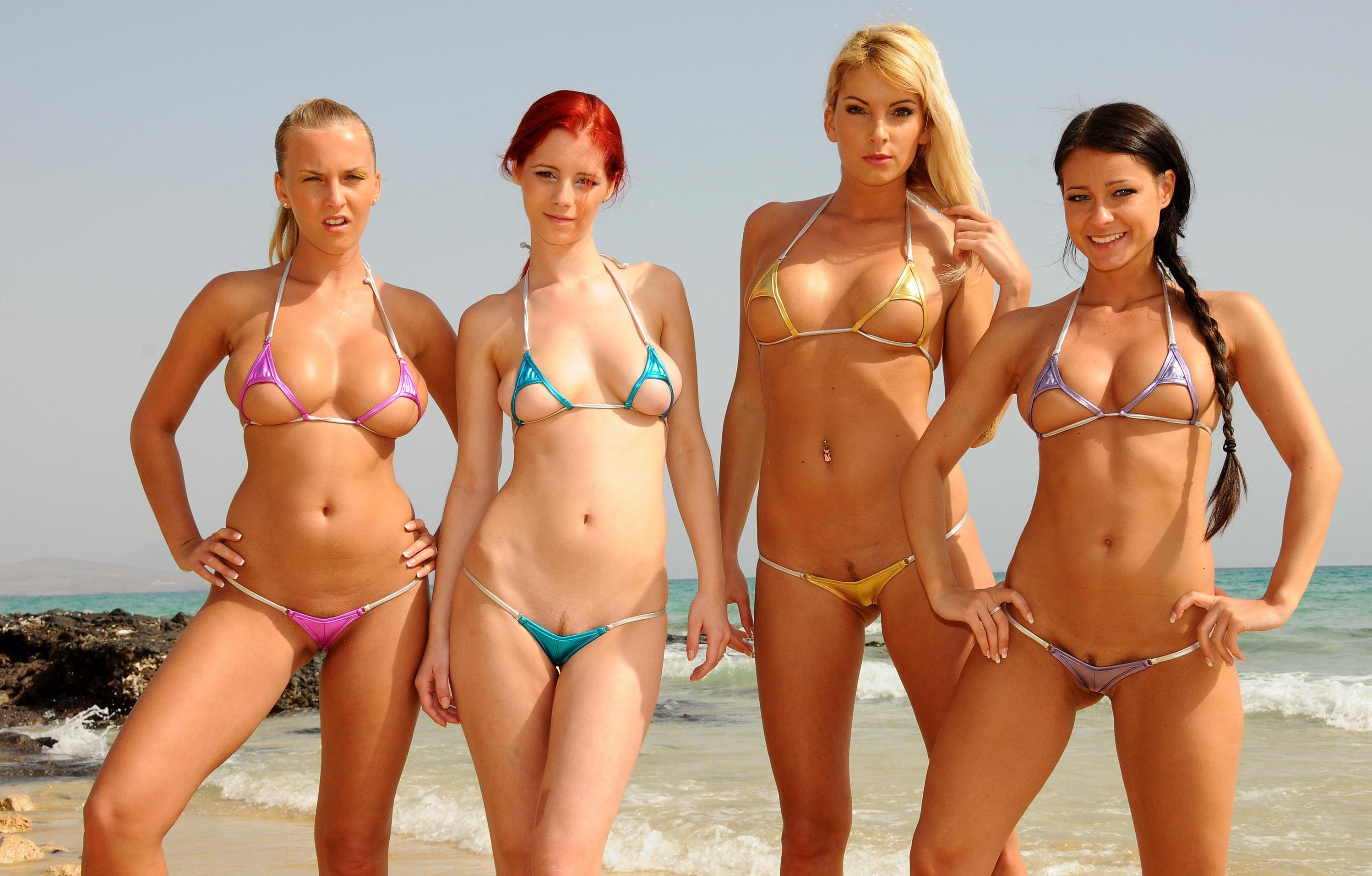 Girls wearing micro bikini on beach