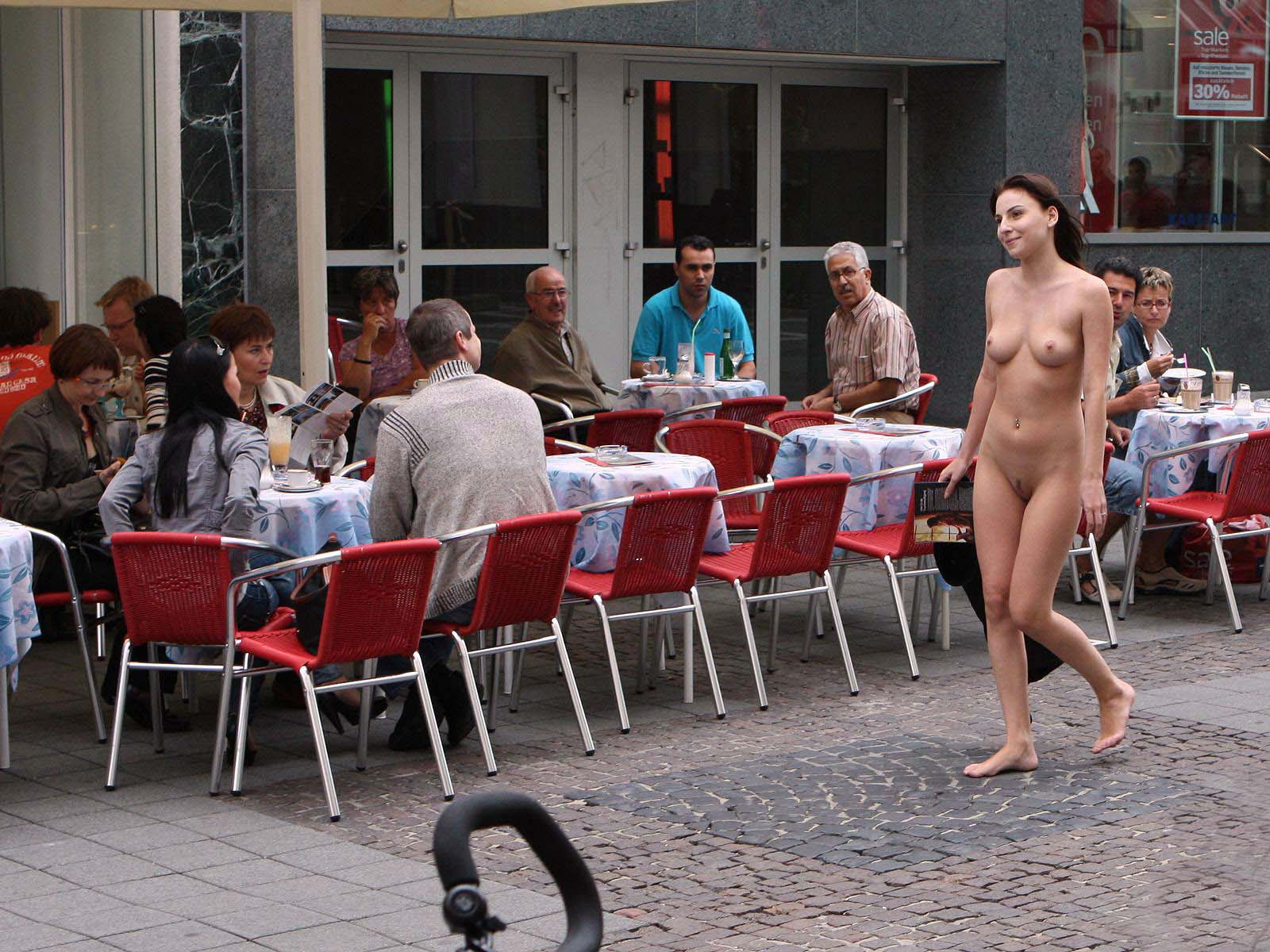 Teen walking naked near the cafe bar draw attention