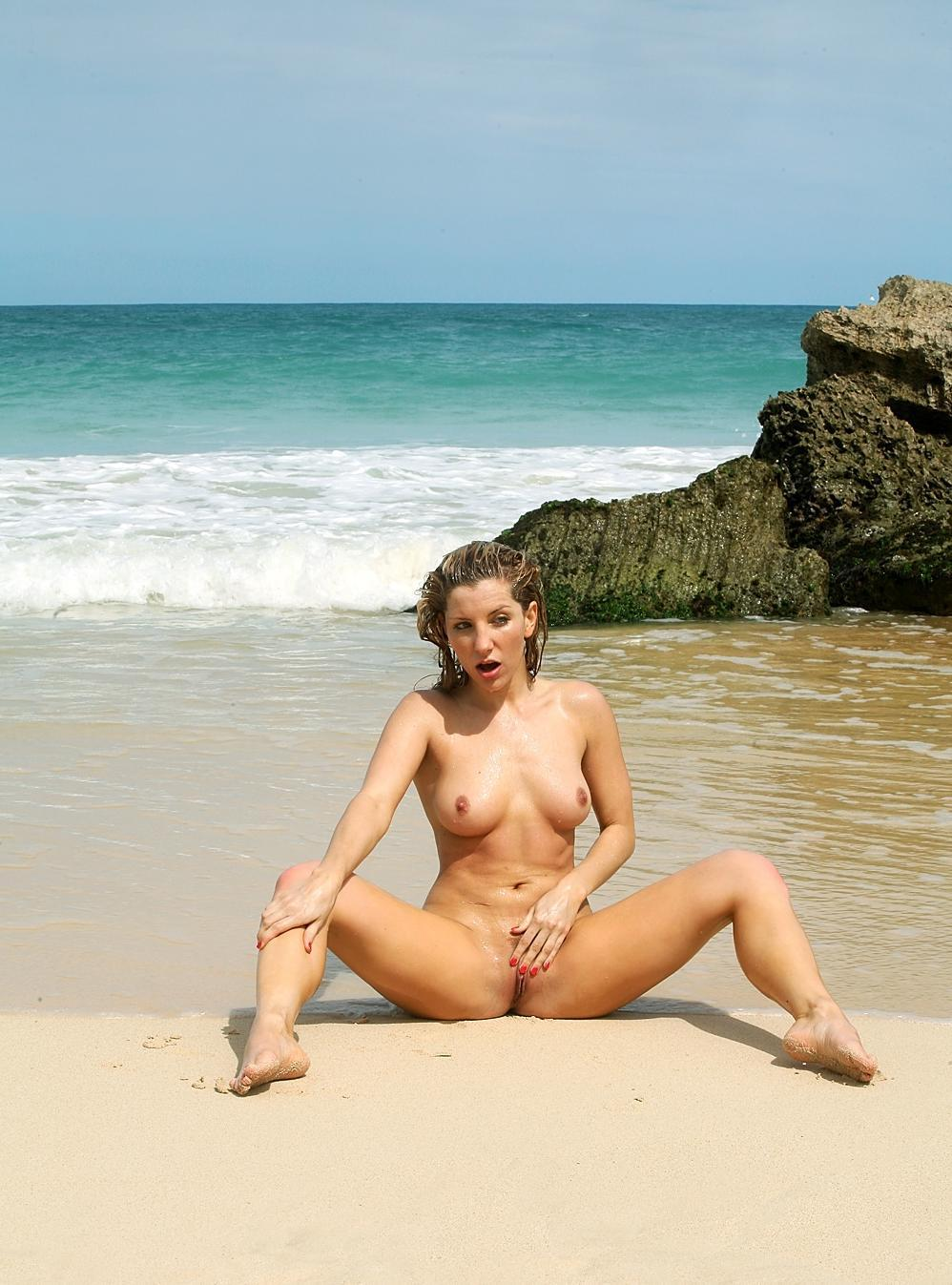 nude female woman masturbating on beach