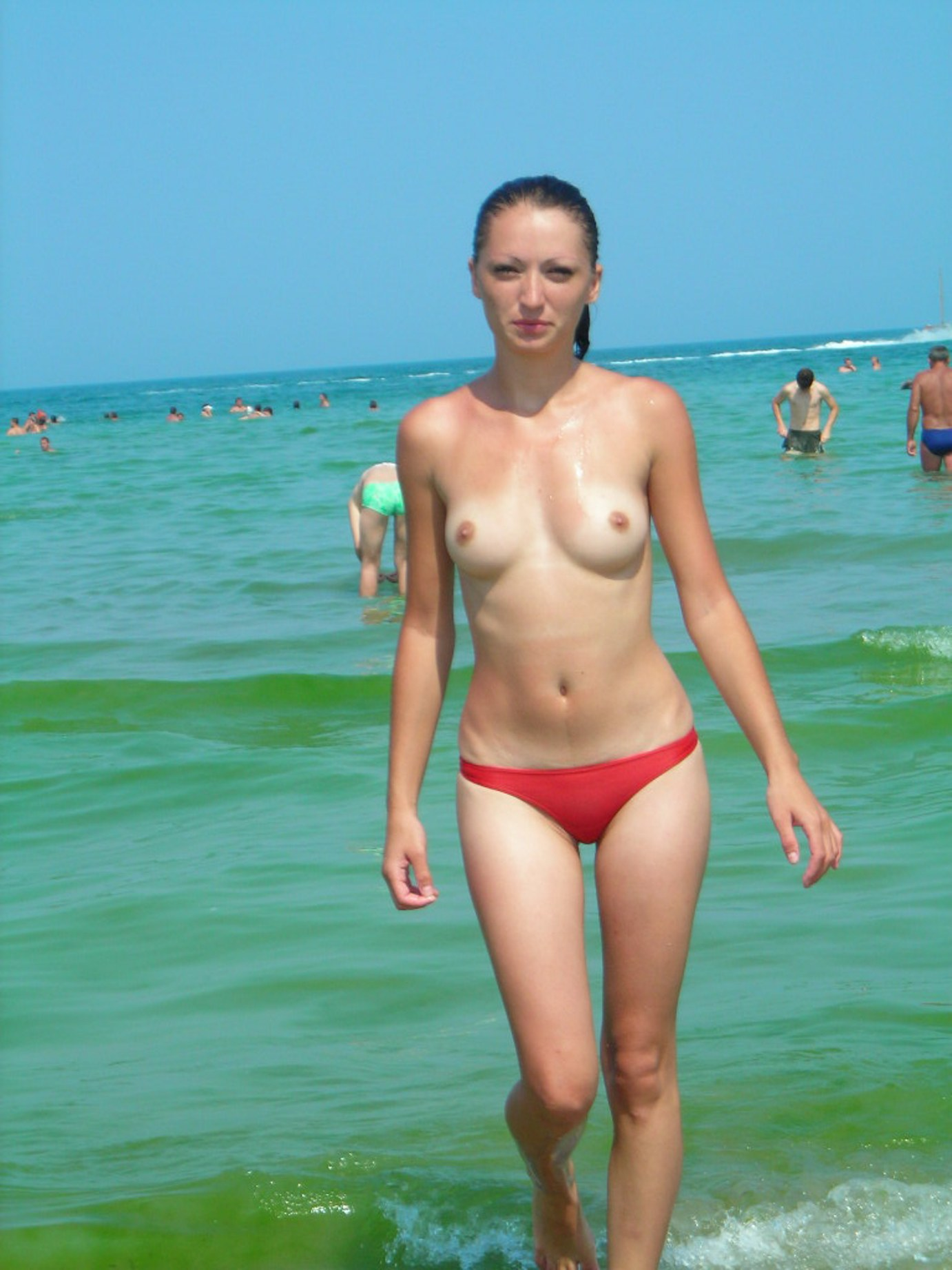 Topless and wet girl wearing red thongs