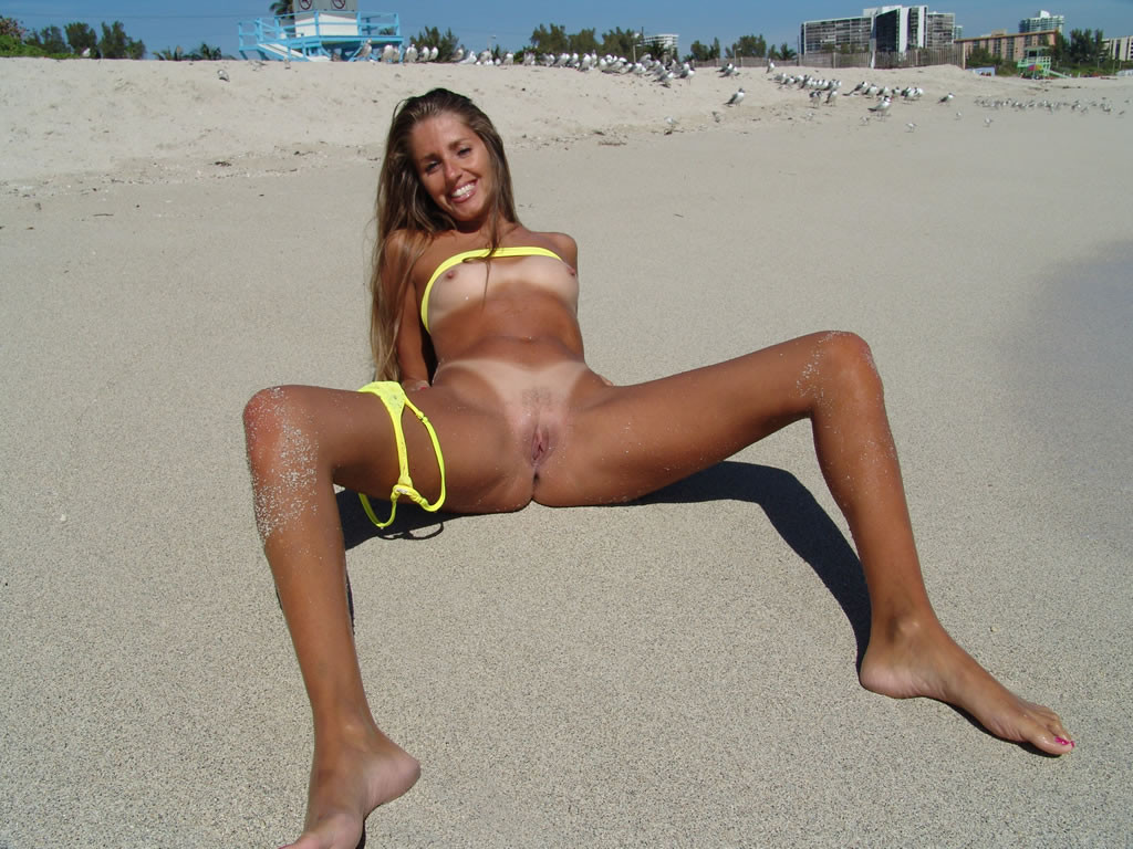 Horny girl at nude beach 15